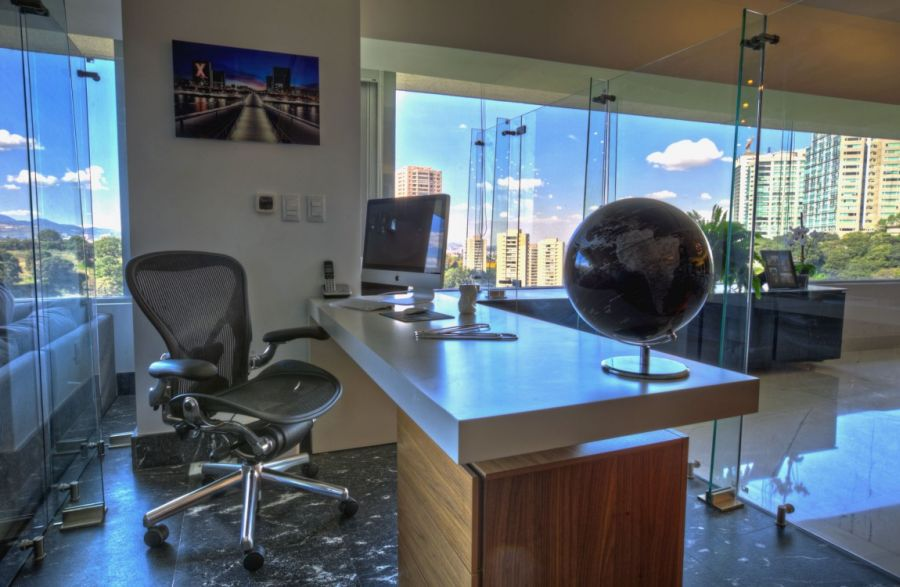 Home office concealed in glass