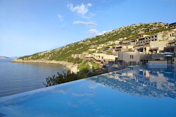 Infinity-edge pool overlooking the coast at Daios Cove Luxury Resort