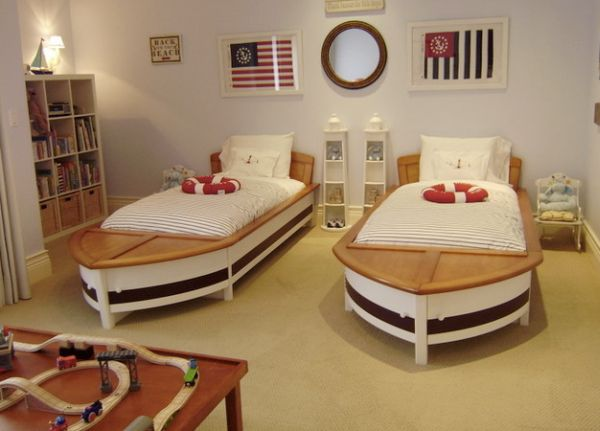 It is the smartly placed mirror that completes this boys' bedroom with twin sailboat beds