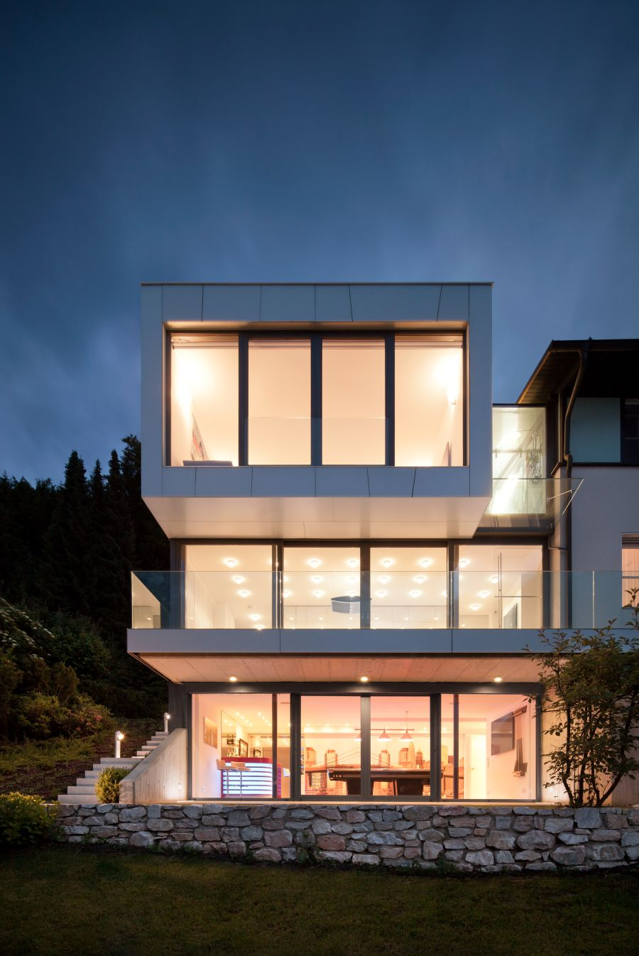 Large glass windows used to offer lake views Elegant Austrian Home Blends Lovely Lake Views With A Minimalist Interior