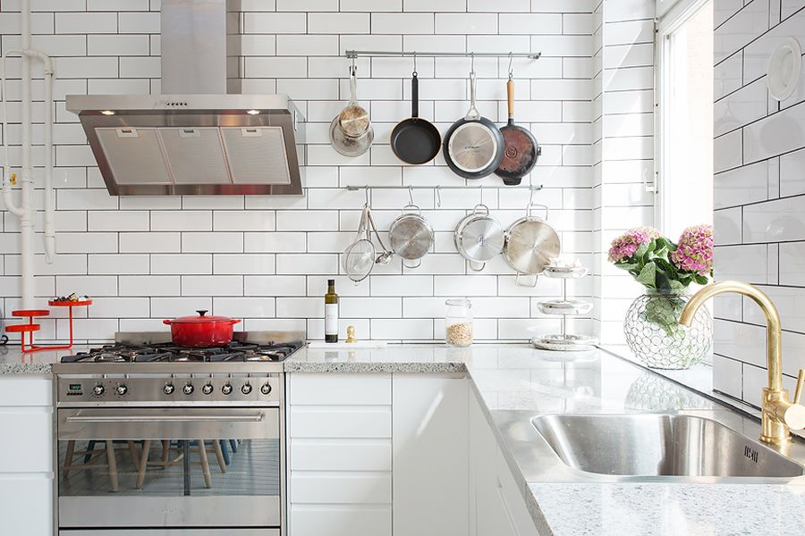 Marble kitchen countetops complement the pristine white walls