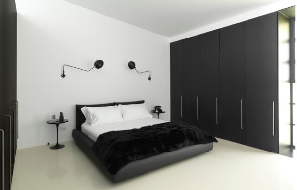 Minimalist bedroom in black and white accentuated by Serge Mouille Rotating Sconces