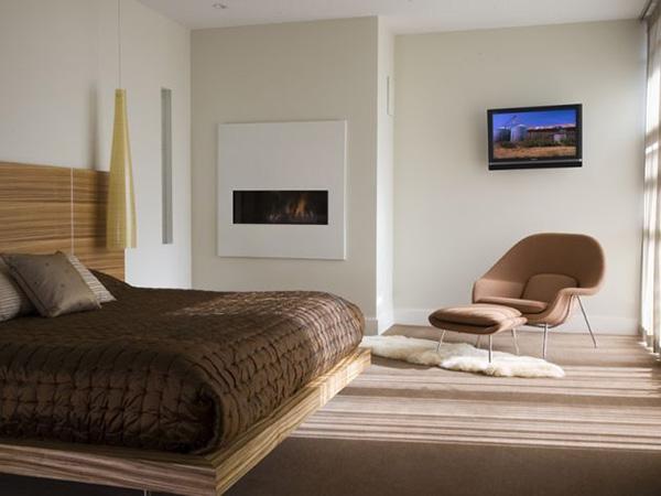 Minimalist bedroom with sleek fireplace