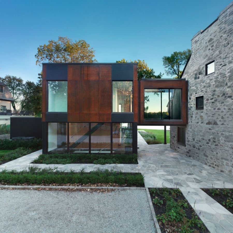 Historic quebec home gets a cool contemporary extension for Modern stone houses architecture