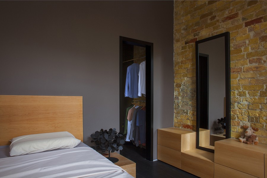 Open closet and mirror in the bedroom