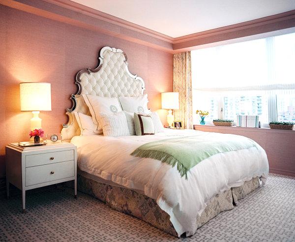 Ornate headboard in a rosy bedroom