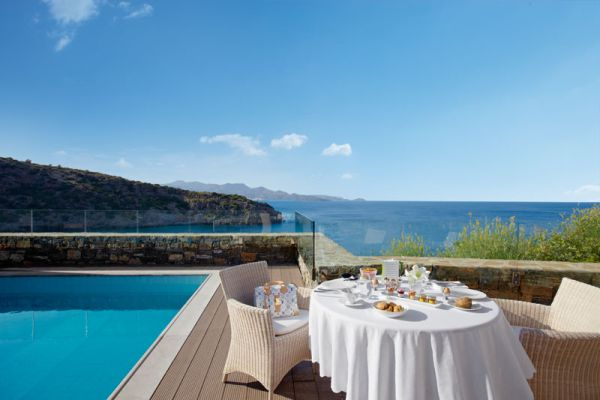 Outdoor dining at Daios Cove Luxury Resort
