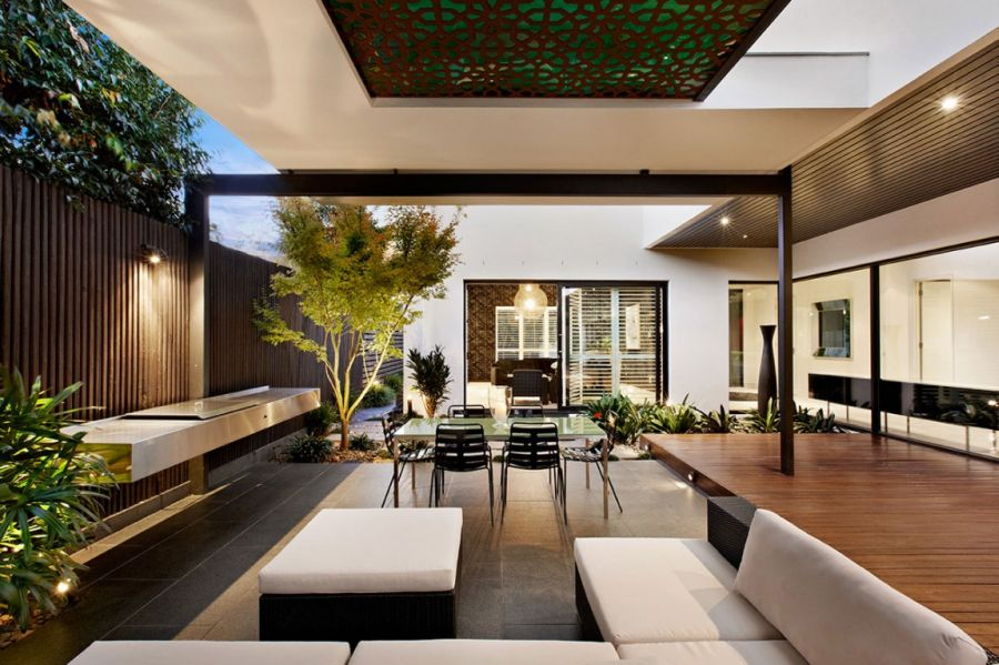 Outdoor seating space at the Balaclava Road Stylish Melbourne Home Dazzles With A Lavish Pool Space
