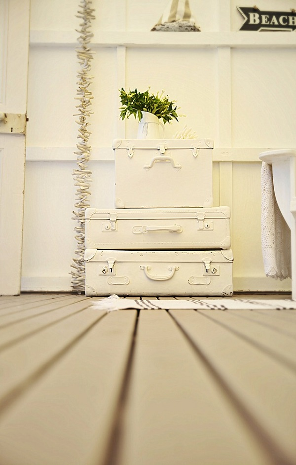 Painted white vintage suitcases