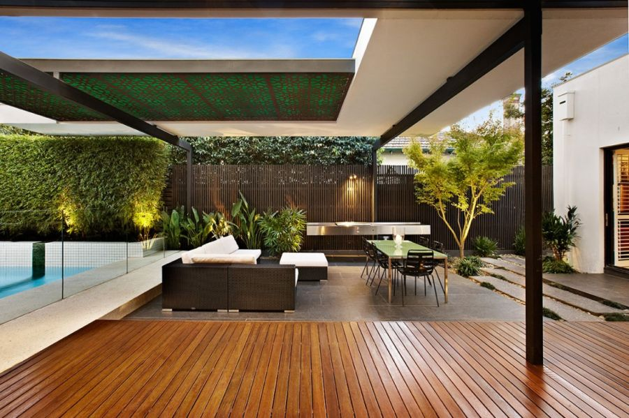 Stylish melbourne home dazzles with a lavish pool space for Terrace seating ideas