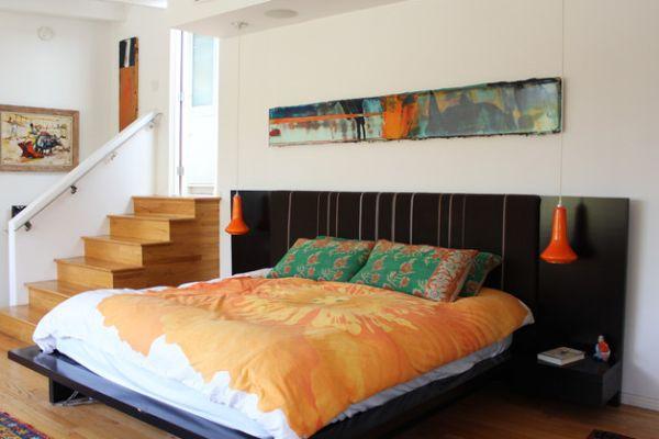 Pops of orange always create a vibrant bedroom