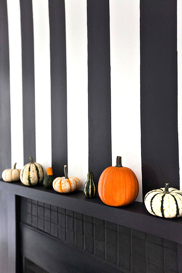 Pumpkins and squash on a mantel