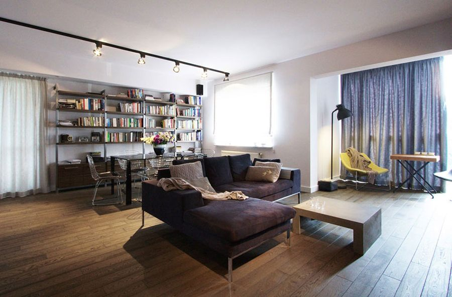 Rail lighting in the living room of the Mokotów apartment Stylish Apartment In Poland Charms With Cool Industrial Overtones