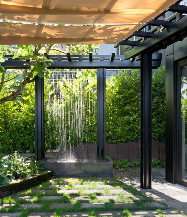 Rainwater channeled through pipes to create artificial waterfalls in the pergola