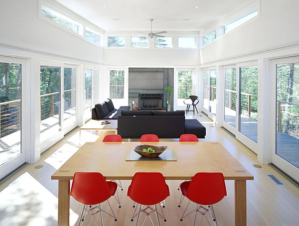 Red chairs around a wooden dining table