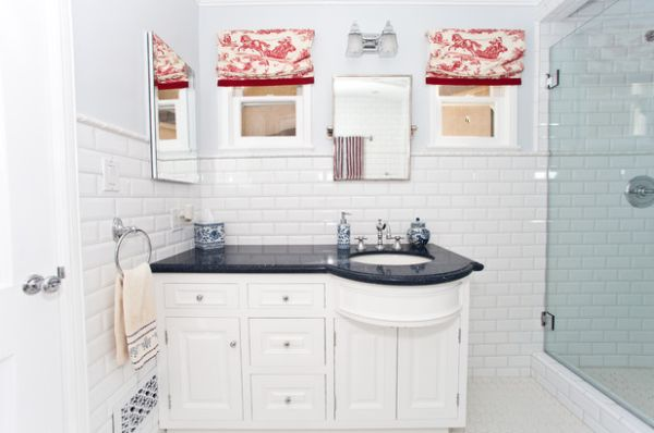 Red on white toile design warms up the bathroom in white