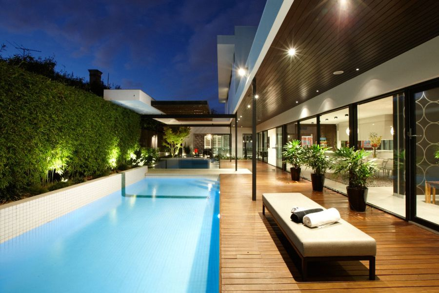 Stylish melbourne home dazzles with a lavish pool space for Modern contemporary swimming pools