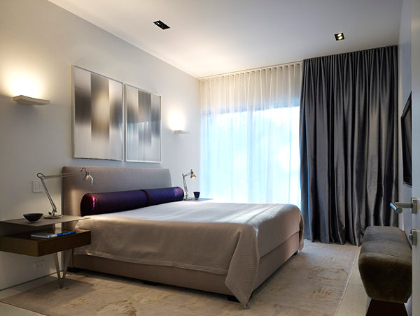 Sconce lighting in a contemporary bedroom
