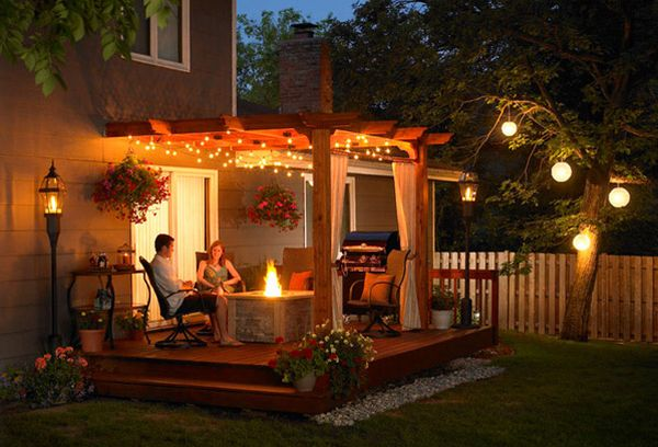Simple patio pergola with fireplace at its heart - For those romantic evenings outdoors!