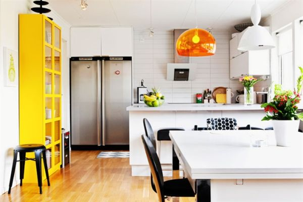 Sizzling orange brightens the kitchen in white