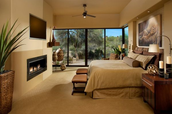 Sleek fireplace sits elegantly in this picture-perfect bedroom