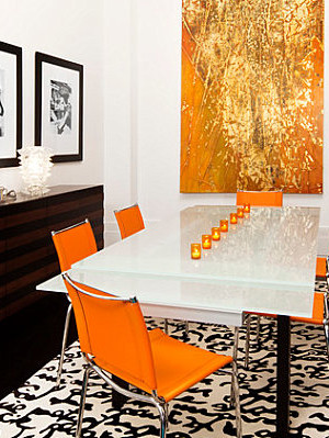 Sleek orange dining chairs
