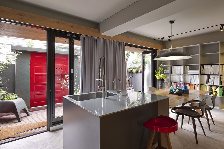 Sliding glass doors connect the living space to the backyard