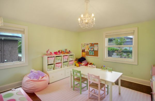 Soft hues of pink and green combined in the playroom