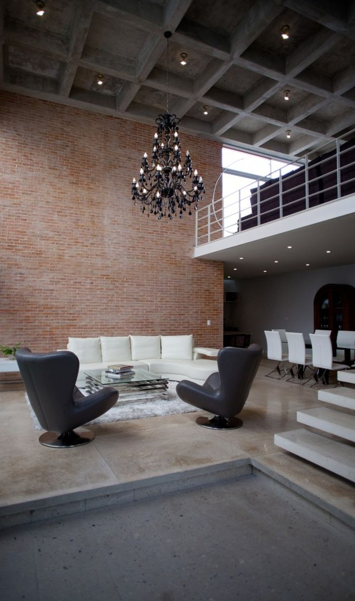 Spacious living room with exposed brick