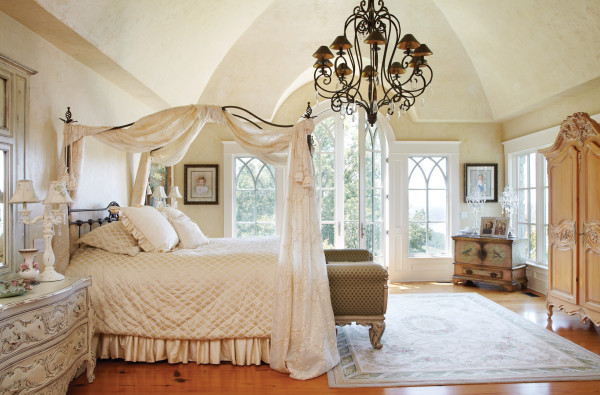 St Louis Homes Mag wrought iron canopy bed with wrought iron chandelier