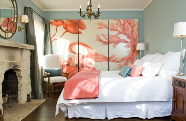 Stone fireplace adds hints of rustic charm to bedroom in coral and blue