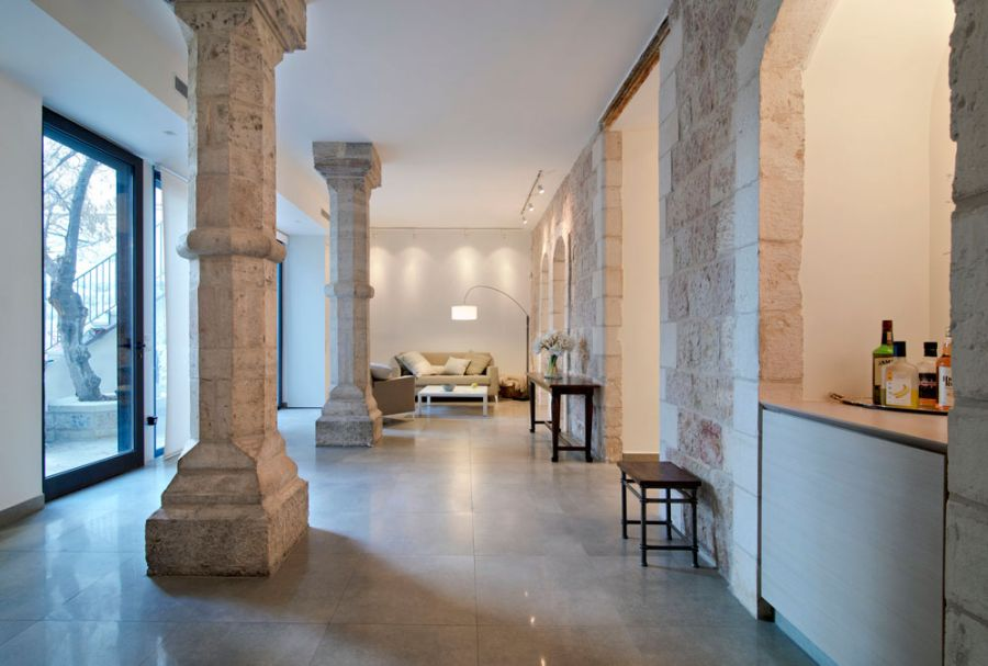 Stone pillars of the renovated Mahane Yehuda apartment Jerusalem Apartment Where Modern Minimalism Meets Old World Charm!