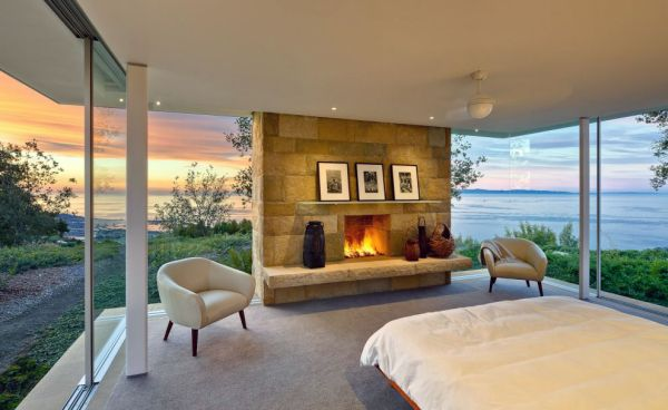 Stunning view combined with stone fireplace make a truly romantic bedroom
