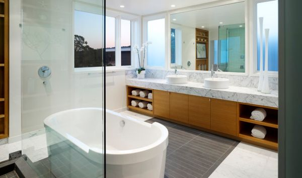 Stylishly placed rolled towels in the contemporary bathroom