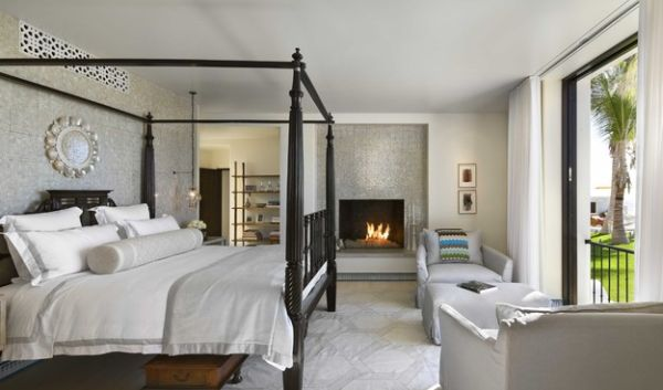 Throw in a four-poster bed along with the fireplace to complete the exotic getaway style!
