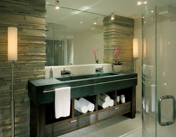 Towel display adds warm texture to the bathroom dominated by stone and wood