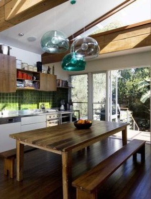Trio of FLY pendant lights in a rustic kitchen