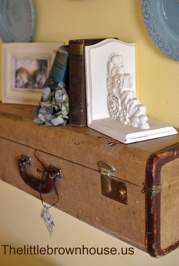 Vintage suitcase used as shelf