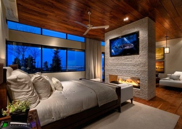 Wall mounted TV placed elegantly above the stylish fireplace