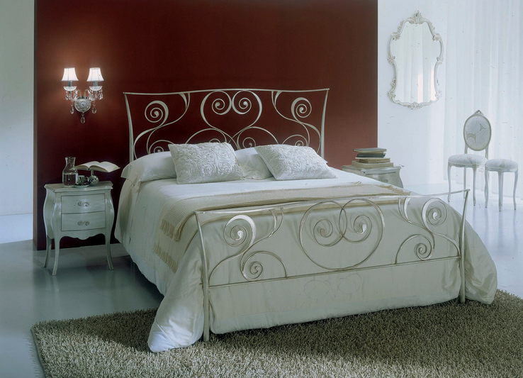white bontempi macrame wrought iron bed against brown wall
