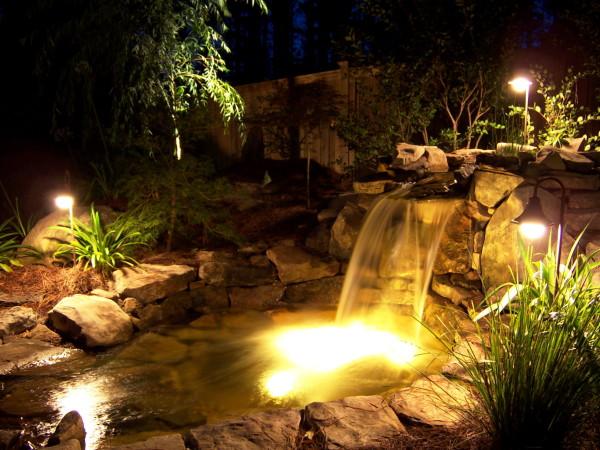 beautiful lighting from underwater floods on waterfall