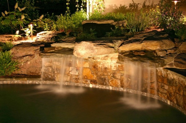 water feature and garden lighting with pond
