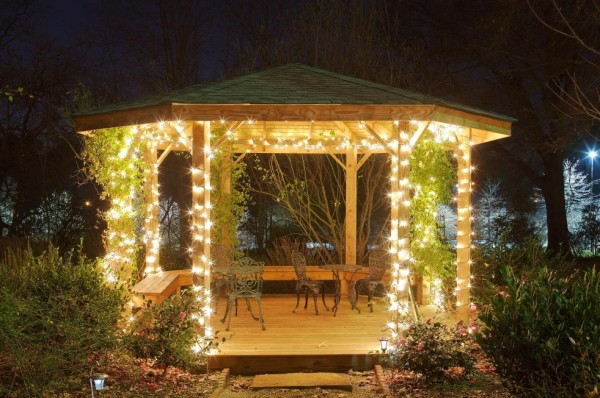 bright garden gazebo shines at night