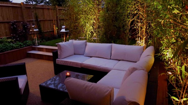 garden lounge with lighting below plants