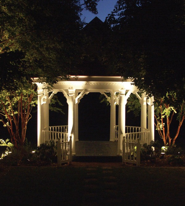 well lit gazebo in garden