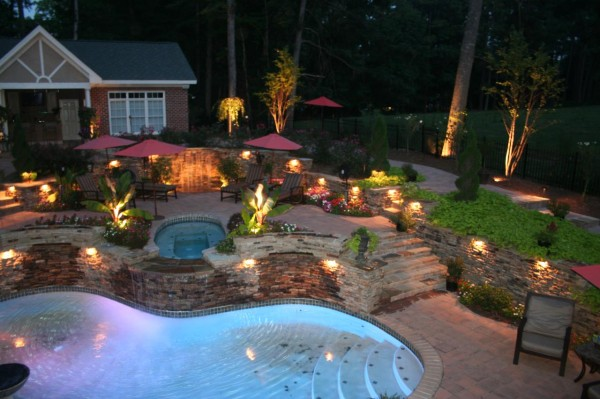 highlighted flower beds and pool