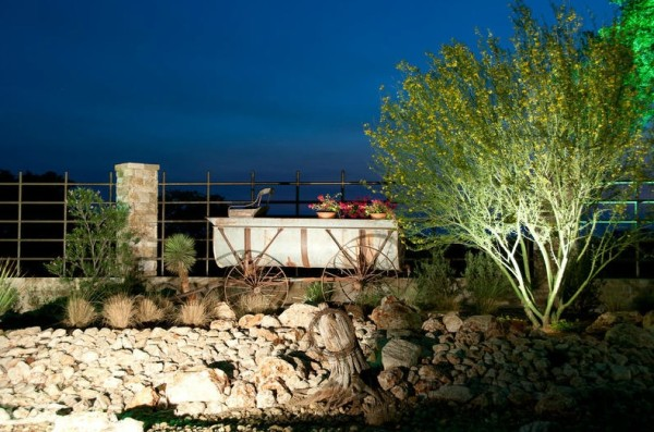 garden lighting with old wooden wagon