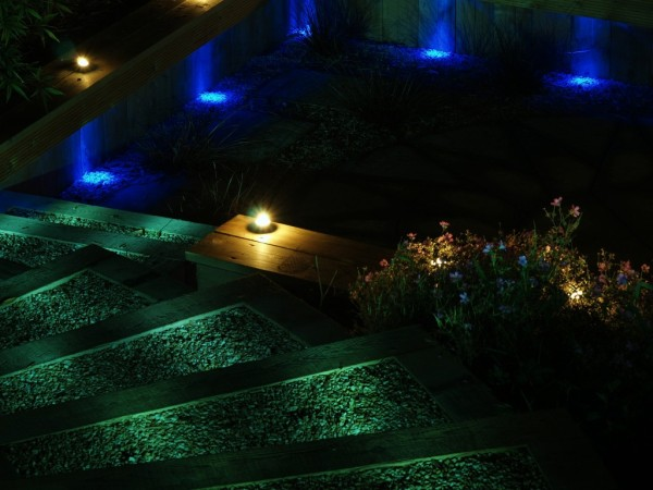 blue green and yellow lighting for dramatic effect in garden