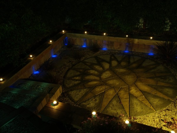 floodlight accentuates stone pattern in garden