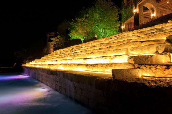 automated lighting on garden waterfall